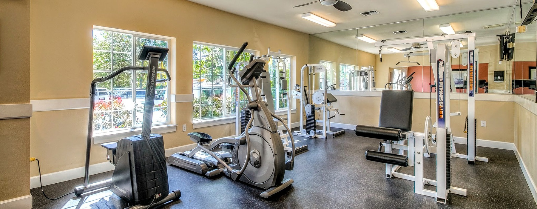 fitness center with large windows